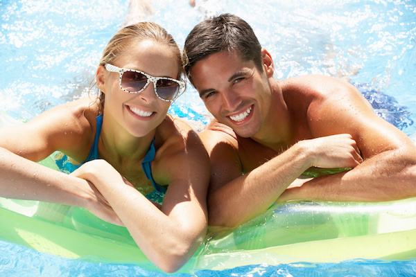 Man and Woman in Swimming Pool on Rafts, pool service melbourne fl, Aqua Blue Pools and Spa