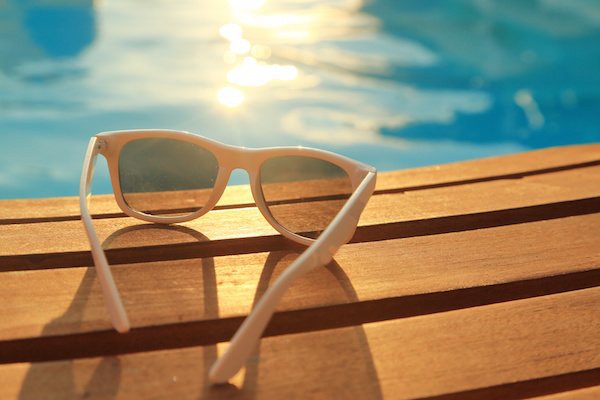 sunglasses by pool, history of swimming pools in America