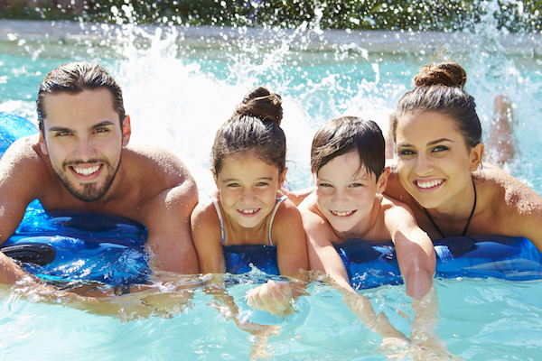 Parents and kids in swimming pool, melbourne pool builder