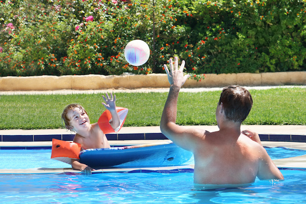 father and son in pool