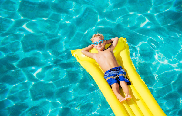 Kid relaxing in pool