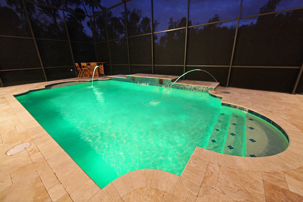 a swimming pool with green LED lighting